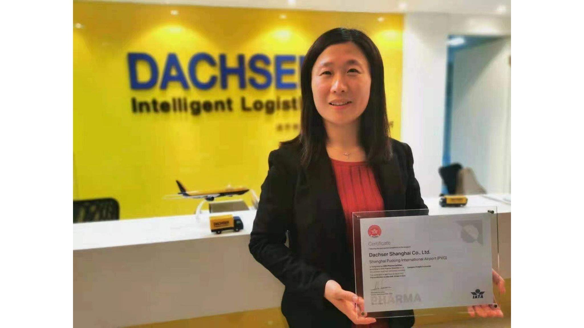 Michelle Jiang, Team Leader Life Science & Healthcare Air & Sea Logistics North China, delightedly receiving the IATA's CEIV Pharma Certificate for Dachser Shanghai